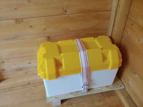 Battery box with a yellow lid